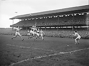 Dublin and Derry get into a tackle mid air during the All Ireland Senior Gaelic Football final Dublin vs Derry in Croke Park on 28th September 1958. Dublin 2-12 Derry 1-9.