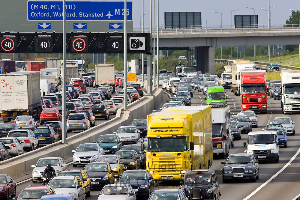 Traffic congestion of cars and trucks at a standstill in both directions on M25 motorway, London, United Kingdom