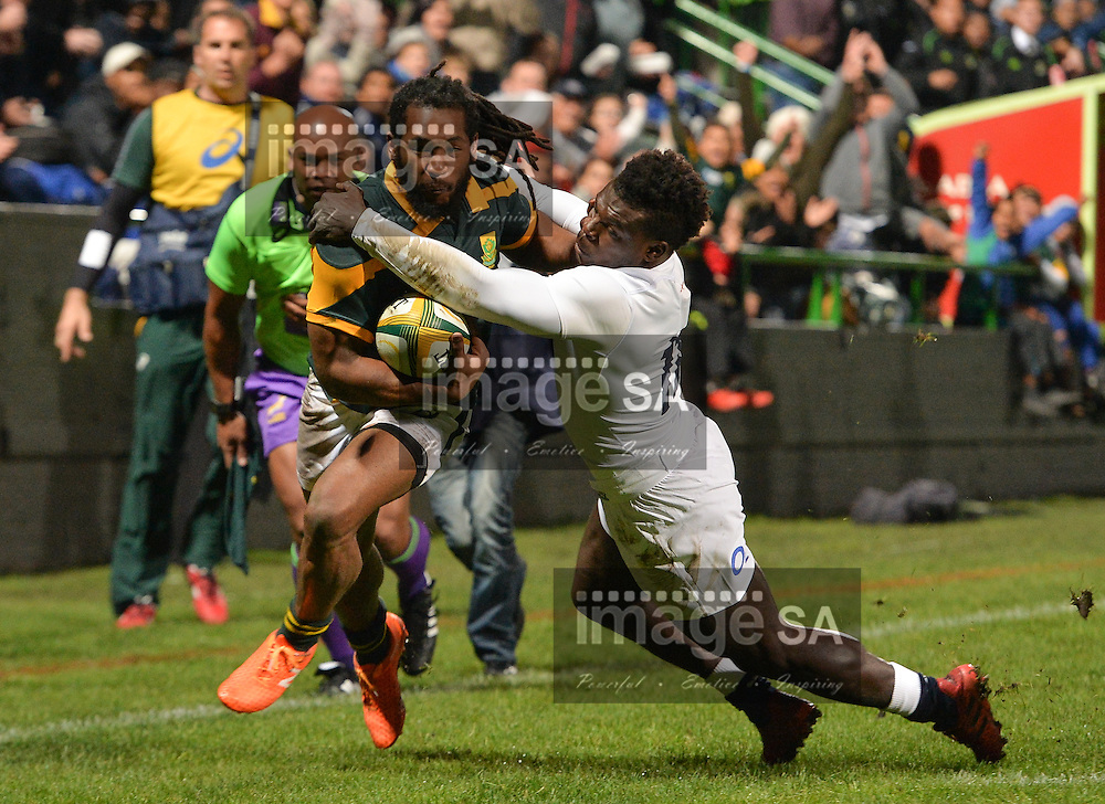 GEORGE, SOUTH AFRICA - JUNE 17: Sergeal Petersen of South Africa tries to pass Christian Wade of England during the match between South Africa 'A' and England Saxons at Outeniqua Park on June 17 2016 in George, South Africa. (Photo by Roger Sedres/Gallo Images)