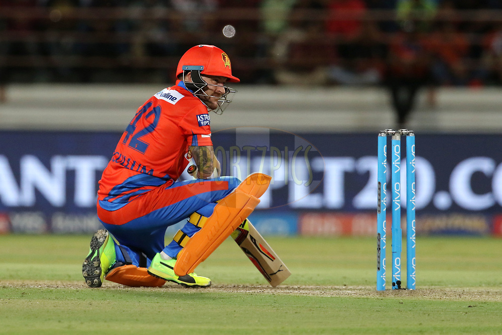 Brendon McCullum of the Gujarat Lions reacts after hit by a ball bowled by Sreenath Arvind of the Royal Challengers Bangalore during match 20 of the Vivo 2017 Indian Premier League between the Gujarat Lions and the Royal Challengers Bangalore  held at the Saurashtra Cricket Association Stadium in Rajkot, India on the 18th April 2017<br /> <br /> Photo by Vipin Pawar - Sportzpics - IPL