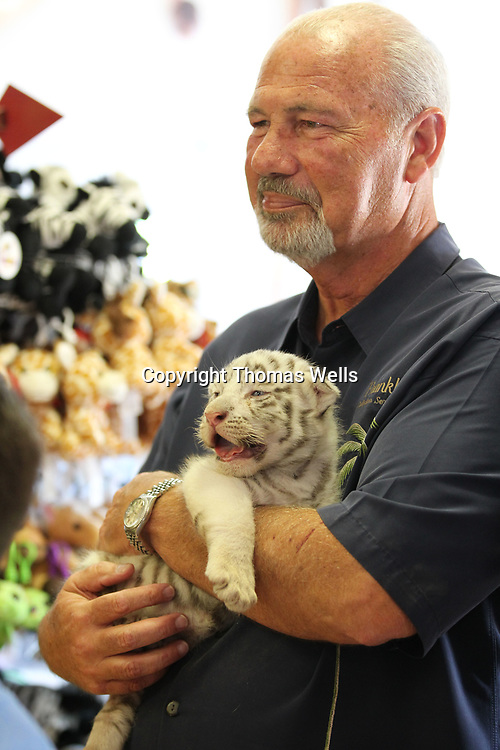 Dan Franklin holds one of two tiger cubs at the Tupelo Buffalo Park on Wendesday.