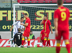 LLANELLI, WALES - Wednesday, August 15, 2012: Wales' Darcy Blake looks dejected as Bosnia-Herzegovina's Vedad Ibisevic celebrates scoring the first goal during the international friendly match at Parc y Scarlets. (Pic by David Rawcliffe/Propaganda)