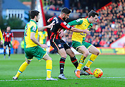 Norwich City midfielder Robbie Brady, AFC Bournemouth midfielder Andrew Surman and Norwich City midfielder Jonathan Howson during the Barclays Premier League match between Bournemouth and Norwich City at the Goldsands Stadium, Bournemouth, England on 16 January 2016. Photo by Graham Hunt.