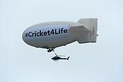 An airship and helicopter circling in the sky above Lords during the ICC Cricket World Cup 2019 Final match between New Zealand and England at Lord's Cricket Ground, St John's Wood, United Kingdom on 14 July 2019.