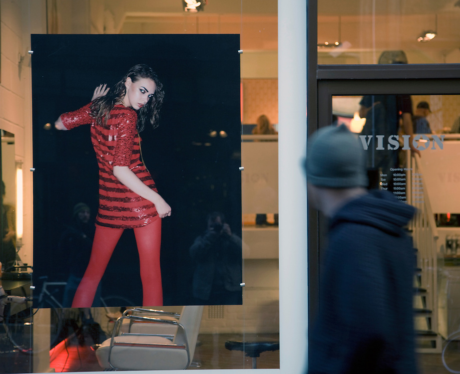 andy spain architectural photography man looking at poster of women in shop window