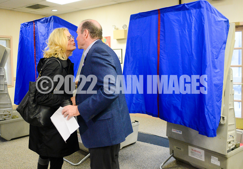 Scott Wallace (right) shares a kiss with his wife Christy Wallace after the Democratic congressional candidate in the first district voted with his family  Tuesday, November 06, 2018 at Buckingham Township Building in Buckingham. [WILLIAM THOMAS CAIN / PHOTOJOURNALIST]