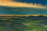 Killdeer Badlands at sunset with approaching storm. East Block.<br /> Grasslands National Park<br /> Saskatchewan<br /> Canada