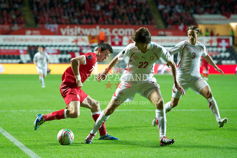 SWANSEA, WALES - Friday, October 7, 2011: Wales' Gareth Bale in action against Switzerland during the UEFA Euro 2012 Qualifying Group G match at the Liberty Stadium. (Pic by Chris Brunskill/Propaganda)