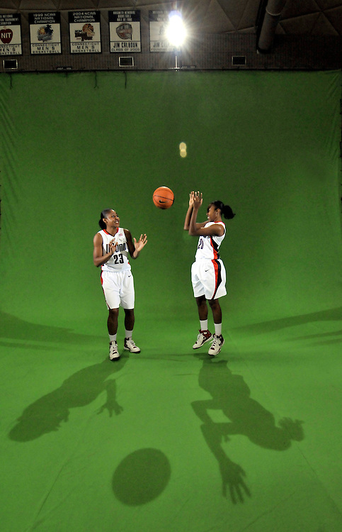 Connecticut's Maya Moore, left, and Renee Montgomery have a playful moment during a women's college basketball media day video shoot at Gampel Pavilion in Storrs, Conn., Thursday, Oct. 16, 2008.  (AP Photo/Jessica Hill)