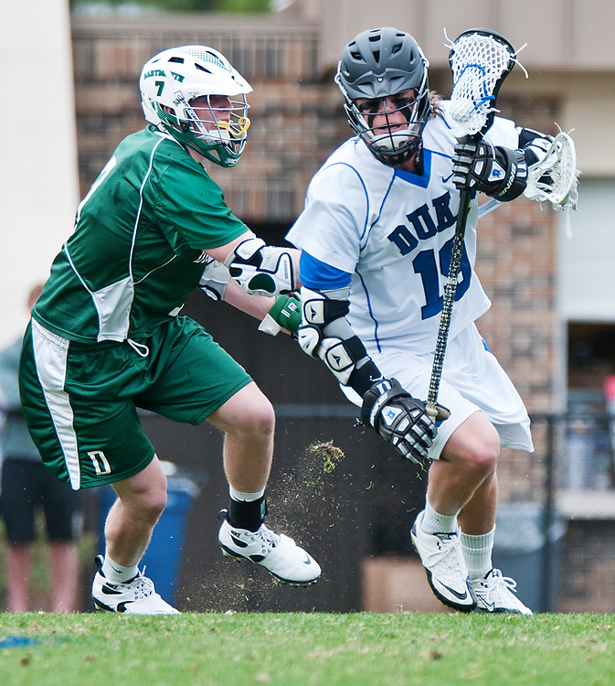 March 20 2011:Duke attack Christian Walsh (19) drives behind the goal.