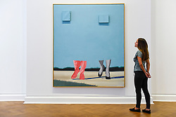 "© Licensed to London News Pictures. 10/09/2019. LONDON, UK. A staff member views ""Untitled"" (Blue Sky), 1962, at a preview of ""Visualising the Sixties"", the first in depth exhibition of works by artist James Rosenquist.  From a painter of commercial billboards in New York City, to a fine art career as a Pop artist, Rosenquist's work was described as Andy Warhol's favourite.  The exhibition is on at Galerie Thaddaeus Ropac in Mayfair 10 September to 9 November.  Photo credit: Stephen Chung/LNP"