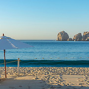 Beach chairs and umbrellas at El Medano beach. Cabo San Lucas Bay. BCS.