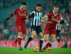 LIVERPOOL, ENGLAND - Saturday, March 3, 2018: Liverpool's Alex Oxlade-Chamberlain and captain Jordan Henderson challenge Newcastle United's Jacob Murphy during the FA Premier League match between Liverpool FC and Newcastle United FC at Anfield. (Pic by Peter Powell/Propaganda)