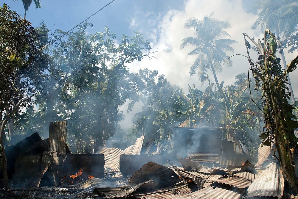 Another house goes up in flames in Bairo Pitie, a area in Dili notorious for gang violence.