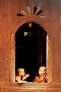 Monks at a window of Shwe Yan Pya  monastery
