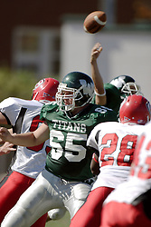 07 October 2006: Offensive Lineman Mike Smith mixes with the defense to give QB Nick Panno time to get off a pass. The Titans of Illinois Wesleyan University started off strong with a touchdown on the 2nd play from scrimmage in the game.  The Titans led most of the way, but failed to maintain the lead in the 4th quarter giving up the decision of this CCIW conference game to the Red Men of Carthage by a score of 31 - 28. Action was at Wilder Field on the campus of Illinois Wesleyan University in Bloomington Illinois.<br />