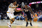 March 27, 2011; Cleveland, OH, USA; Atlanta Hawks small forward Marvin Williams (24) drives past Cleveland Cavaliers shooting guard Alonzo Gee (33) during the fourth quarter at Quicken Loans Arena. The Hawks beat the Cavaliers 99-83. Mandatory Credit: Jason Miller-US PRESSWIRE
