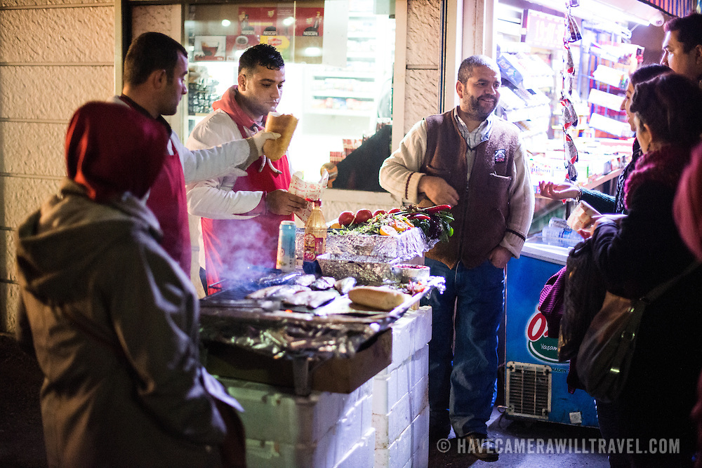 Vendors grilling fresh fish in Karakoy, Istalnbul.