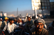 Migrant day laborers crowd a square in search of work in Kabul, Afghanistan August 11, 2009. 41 candidates are due to run in Afghanistan's presidential elections which are to be held on August 20. The incumbent president Karzai is considered to be the frontrunner despite claims of corruption and what many consider an ineffectual government.