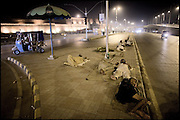 "Homeless heroin addicts sleep on the ground in the middle of the city, right in front of Bala Hisar Fort, one of the most historic places of Peshawar. Pakistan, on monday, August 25 2008.....""Pakistan is one of the countries hardest hits by the narcotics abuse into the world, during the last years it is facing a dramatic crisis as it regards the heroin consumption. The Unodc (United Nations Office on Drugs and Crime) has reported a conspicuous decline in heroin production in Southeast Asia, while damage to a big expansion in Southwest Asia. Pakistan falls under the Golden Crescent, which is one of the two major illicit opium producing centres in Asia, situated in the mountain area at the borderline between Iran, Afghanistan and Pakistan itself. .During the last 20 years drug trafficking is flourishing in the Country. It is the key transit point for Afghan drugs, including heroin, opium, morphine, and hashish, bound for Western countries, the Arab states of the Persian Gulf and Africa..Hashish and heroin seem to be the preferred drugs prevalence among males in the age bracket of 15-45 years, women comprise only 3%. More then 5% of whole country's population (constituted by around 170 milion individuals),  are regular heroin users, this abuse is conspicuous as more of an urban phenomenon. The substance is usually smoked or the smoke is inhaled, while small number of injection cases have begun to emerge in some few areas..Statistics say, drug addicts have six years of education. Heroin has been identified as the drug predominantly responsible for creating unrest in the society."""