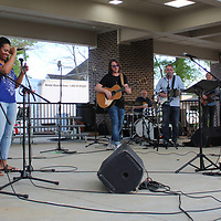 Performers christen the new Frisco Park stage for the community worship service.