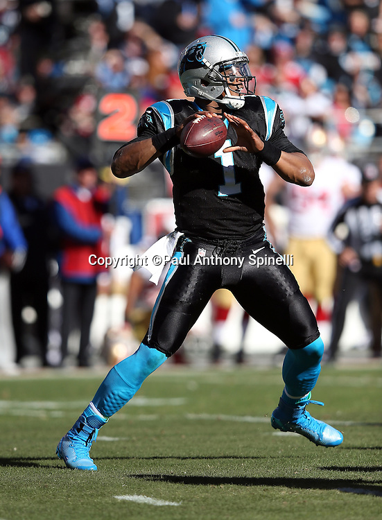 Carolina Panthers quarterback Cam Newton (1) throws a pass in the second quarter during the NFC Divisional Playoff NFL football game against the San Francisco 49ers on Sunday, Jan. 12, 2014 in Charlotte, N.C. The 49ers won the game 23-10. ©Paul Anthony Spinelli