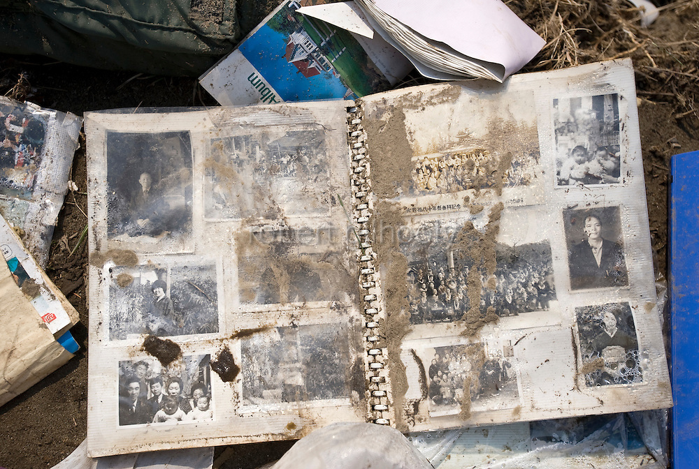 A Photo album lies among the rubble of Nobiru, Miyagi Prefecture, Japan on  25 March 20011. .Photographer: Robert Gilhooly