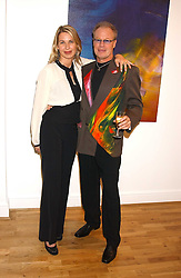 Artist JEFFREY KROLL and SERENA MORTON at an exhibition of art by Jeffrey Kroll entitled Imirage held at the Arndean Gallery, Cork Street, London on 19th October 2005.<br />
