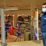 During the coronavirus in UK lockdown people out shopping for food, London.