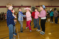 "Inter Lakes Elementary School's annual Square Dance has third graders Charlie Despres and Kayley Wagoner chasse down the line with their fellow ""partners"" Thursday afternoon.   (Karen Bobotas/for the Laconia Daily Sun)"