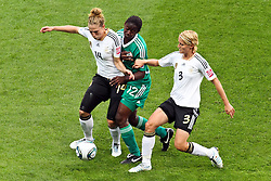 30.06.2011, Commerzbank Arena, Frankfurt, GER, FIFA Women Worldcup 2011, Gruppe A, Deutschland (GER) vs. Nigeria (NGA), im Bild:  Kim Kulig (GER #14, Hamburg) (L) und Saskia Bartusiak (GER #03, Frankfurt) (R) gegen Sarah Michael (Nigeria #12)..// during the FIFA Women Worldcup 2011, Pool A, Germany vs Nigeria on 2011/06/30, Commerzbank Arena, Frankfurt, Germany.  EXPA Pictures © 2011, PhotoCredit: EXPA/ nph/  Mueller *** Local Caption ***       ****** out of GER / CRO  / BEL ******