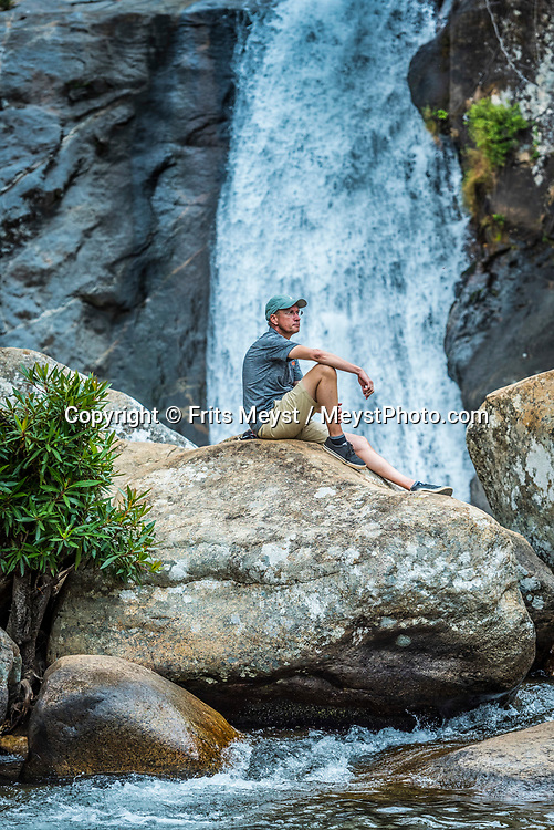 Malawi, July 2017. Hiking to the Waterfall and pools with Trek Mulanje, a local trekking company based in Likhubula, Mulanje in the southern corner of Malawi. Mulanje is one of the highest mountains in Africa with the highest point of the mountain is called Sapitwa. From Sapitwa you can often see the Indian ocean. Malawi is known for its long rift valley and the third largest lake in Africa: Lake Malawi. Malawi is populated with friendly welcoming people, who gave it the name: the warm heart of Africa. In the south the lake make way for a landscape of valleys surrounded by spectacular mountain ranges. Photo by Frits Meyst / MeystPhoto.com