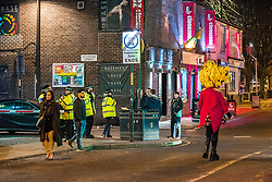 """© Licensed to London News Pictures . 15/12/2017. Manchester, UK. Police in Manchester's """" Gay Village """" .Revellers out in Manchester City Centre overnight during """" Mad Friday """" , named for historically being one of the busiest nights of the year for the emergency services in the UK . Photo credit: Joel Goodman/LNP"""