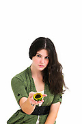 Young female teen offers the viewer a sunflower in the palm of her hand Selective focus on face
