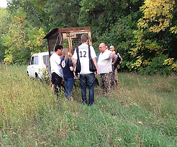 Rescued  - Masha the brown bear. <br /> Masha the brown bear rescued from a group of mafia who ran a bear baiting tournaments.<br /> Four Paws team talk to the owner of Masha about the terms of her release in a field just miles from the Russian border, Ukraine, Monday, 2nd September 2013. Picture by Roger Allen / i-Images