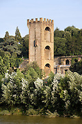 General view of Porta San Niccolo (San Niccolo Gate), 1324, by Andrea Orcagna, Piazza Giuseppe Poggi, Florence, Tuscany, Italy, pictured from the River Arno on June 10, 2007, in the afternoon, surrounded by trees. The Gate of San Niccolo, part of the city walls, guarded the river in partnership with the Zecca Gate on the opposite Northern bank of the Arno. It is the only gate whose height was not reduced during the siege of Florence, 1529. Florence, capital of Tuscany, is world famous for its Renaissance art and architecture. Its historical centre was declared a UNESCO World Heritage Site in 1982. Picture by Manuel Cohen
