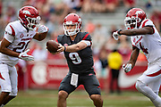 FAYETTEVILLE, AR - MARCH 6:   John Stephen Jones #9 makes a hand off to either Jordon Curtis #20 or Shamar Nash #4 of the Arkansas Razorbacks catches a pass during the annual Spring Game at Razorback Stadium on March 6, 2019 in Fayetteville, Arkansas.  (Photo by Wesley Hitt/Getty Images) *** Local Caption *** John Stephen Jones; Jordon Curtis; Shamar Nash