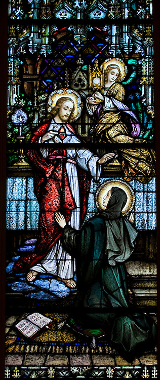 Stained glass image depicting Jesus and his sacred heart inside Sacred Heart Church, Sherwood, Wis. (Sam Lucero photo)