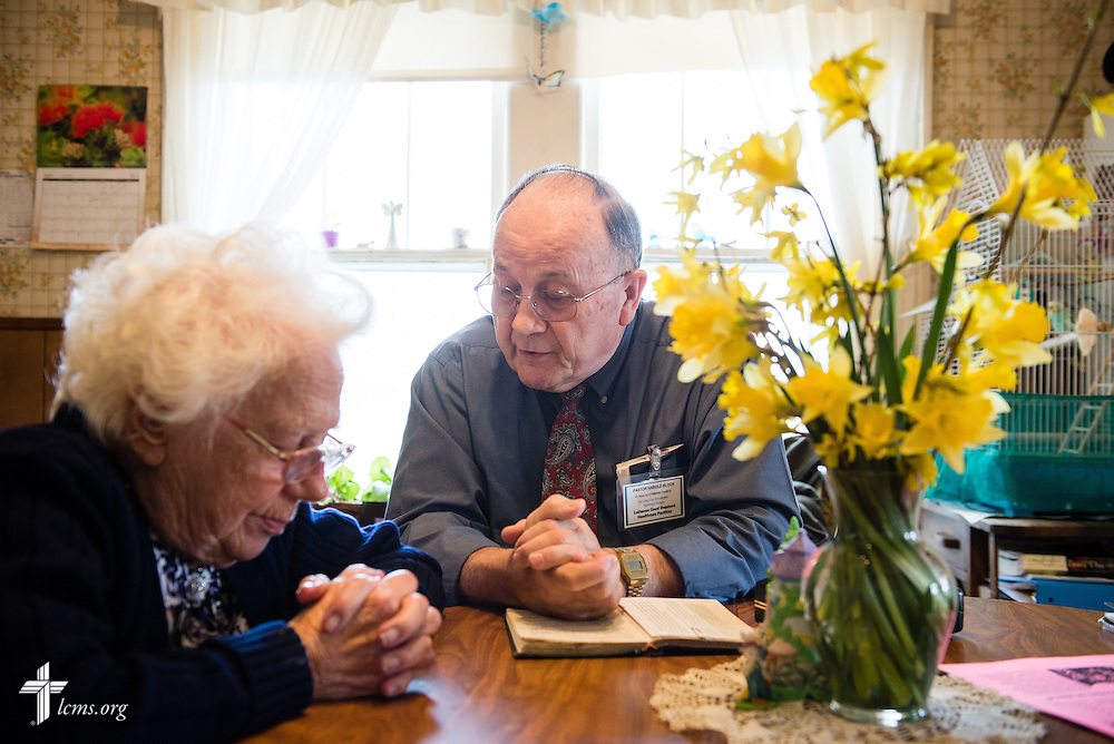 The Rev. Harold Block, visitation pastor at St. Paul's Lutheran Church, prays with a 103 year-old church member at her home outside Concordia, Mo., on Thursday, April 10, 2014. LCMS Communications/Erik M. Lunsford