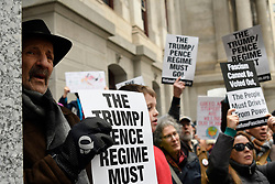 Some of the signs and faces in the crowd of an estimated 175 protestor gathered at the South apron of City Hall to protest President Trumps National Emergency call, during a President's Day protest, on Monday. (Bastiaan Slabbers for WHYY)