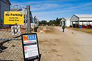 16 JULY 2020 - BOONE, IOWA: A sign warning of COVID-19 at an entrance to the fairgrounds on the first day of the Boone County Fair in Boone. Summer is county fair season in Iowa. Most of Iowa's 99 counties host their county fairs before the Iowa State Fair. In 2020, because of the COVID-19 (Coronavirus) pandemic, many county fairs were cancelled, and most of the other county fairs were scaled back to concentrate on 4H livestock judging. Boone county scaled back its fair this year. The Iowa State Fair was cancelled completely. Boone County Emergency Management did not approve going ahead with the fair, and has advised anyone who goes to the fair to take precautions and monitor themselves for symptoms of the Coronavirus.             PHOTO BY JACK KURTZ