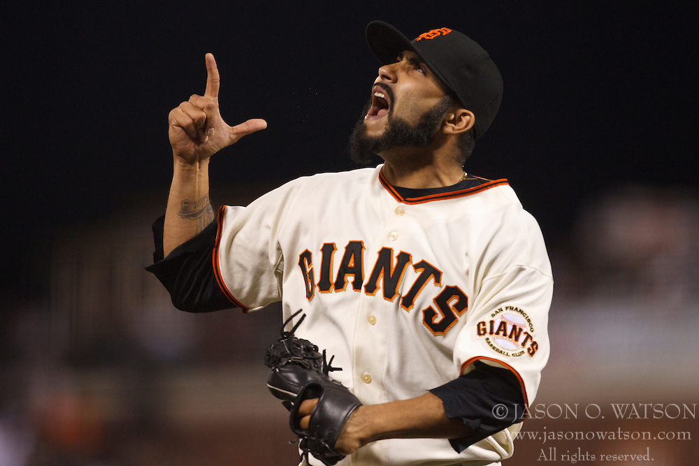 September 15, 2010; San Francisco, CA, USA;  San Francisco Giants relief pitcher Sergio Romo (54) celebrates after forcing Los Angeles Dodgers first baseman John Lindsey (not pictured) to pop out during the eighth inning at AT&T Park.