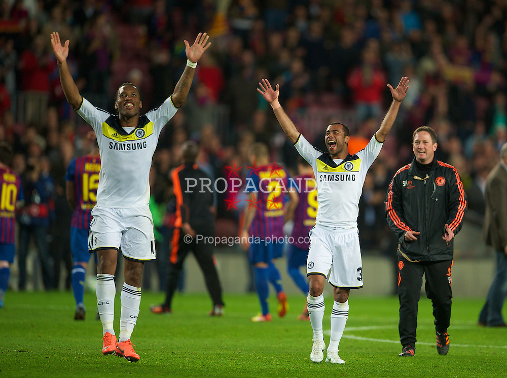 BARCELONA, SPAIN - Tuesday, April 24, 2012: Chelsea's Didier Drogba and Ashley Cole celebrate their side's 3-2 victory over FC Barcelona after the UEFA Champions League Semi-Final 2nd Leg match at the Camp Nou. The game finished 2-2, 3-2 on aggregate. (Pic by David Rawcliffe/Propaganda)