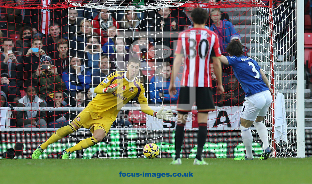 Costel Pantilimon of Sunderland dives the right way but Leighton Baines (r) of Everton equalizes during the Barclays Premier League match at the Stadium Of Light, Sunderland<br /> Picture by Simon Moore/Focus Images Ltd 07807 671782<br /> 09/11/2014