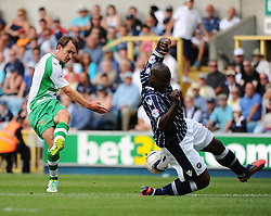 Yeovil Town's James Hayter has his shot blocked by Millwall's Danny Shittu - Photo mandatory by-line: Seb Daly/JMP - Tel: Mobile: 07966 386802 03/08/2013 - SPORT - FOOTBALL - The Den - Millwall -  Millwall V Yeovil Town - Sky Bet Championship