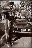 Micahel Jordan wearing first generation Air Jordans after his rookie season in the NBA.  Photographed on the campus of UNC in 1985 for the famous 24 hour fried chicken joint, Time Out.