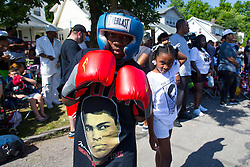 Malik Parker who trains at TKO gym in Louisville brought his boxing gear to Muhammad Ali's childhood home on Grand Avenue, Friday, June 10, 2016.
