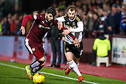 Hearts FC Defender Callum Paterson and Aberdeen FC Midfielder Niall McGinn battle during the Scottish Cup fourth round match between Heart of Midlothian and Aberdeen at Tynecastle Stadium, Gorgie, Scotland on 9 January 2016. Photo by Craig McAllister.