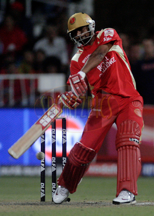 DURBAN, SOUTH AFRICA - 1 May 2009. Praveen Kumar plays a shot during the IPL Season 2 match between Kings X1 Punjab and the Royal Challengers Bangalore held at Sahara Stadium Kingsmead, Durban, South Africa..
