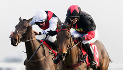Culture De Sivola, (right) ridden by Lizzie Kelly comes home to win The 32Red Casino Mares' Handicap Hurdle during day two of 32Red Winter Festival at Kempton Park Racecourse.
